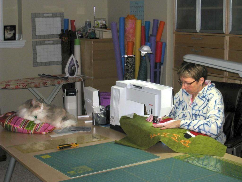 Jen at her sewing machine making Santa Sacs
