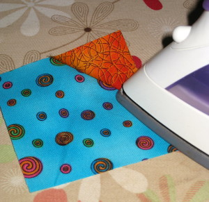 Press triangle of fabric towards corner.