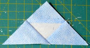 Press seam towards triangle.