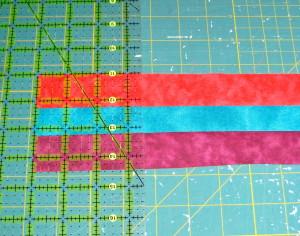 Align ruler on squared off end of strip set.