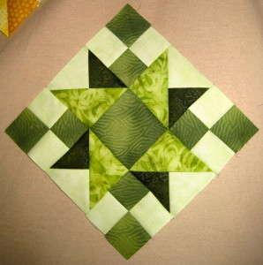 One light, one dark and two medium greens make up this nicely balanced block.