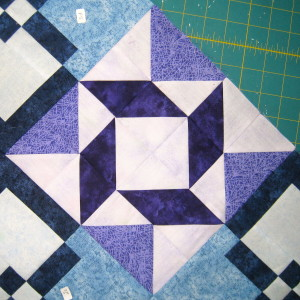 Adding in a medium value gives the block balance between the three fabrics and creates a block that is no longer boring.