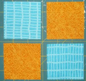 Sew medium turquoise and yellow orange squares together.