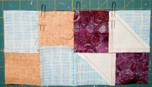 Rows pinned together at seams with forked pins.