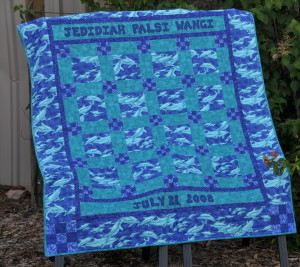 Even thought he dolphins are lighter there is little to no contrast in the quilt seeing how mostly medium valued fabrics were used.