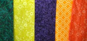 Purple dominant split complimentary plus scheme using fabric