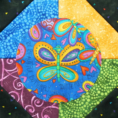 Fussy cut circle on a multicoloured snowball block