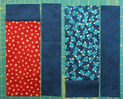 A modern quilt with the modern fabric line called Simple Marks with fabrics laid out in position in block