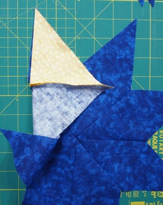 sew triangle in place on other side