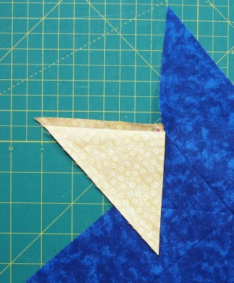 sew to star stopping a ¼″ from end of triangle