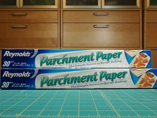 parchment paper alternative If you're making somthing like a cake where the paper will be completely covered, you can use waxed paper.