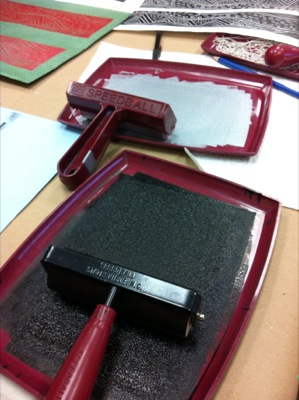 black ink on a tray and roller
