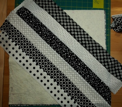 Several strips sewn together on the batting