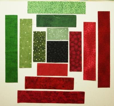 fabric pieces arranged around black centre