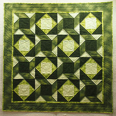Woven stars quilt completed in green