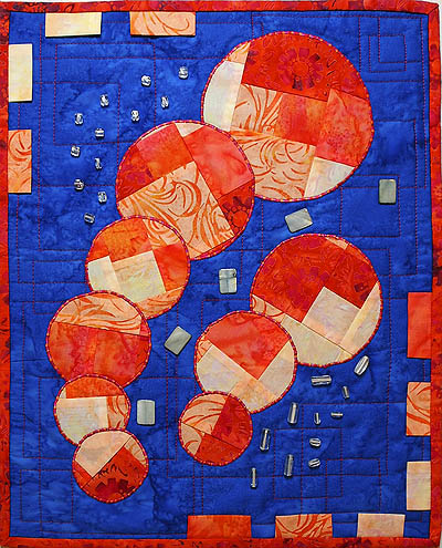 Embellishing with fabric and beads to complete an art quilt