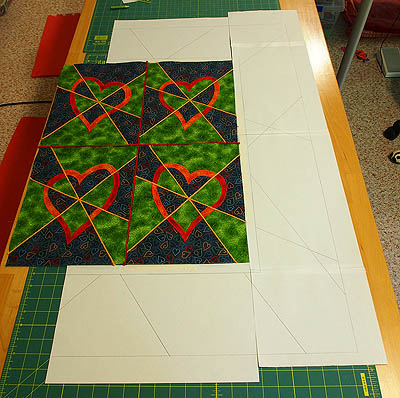 Paper along side quilt to draft border with paper and pencil