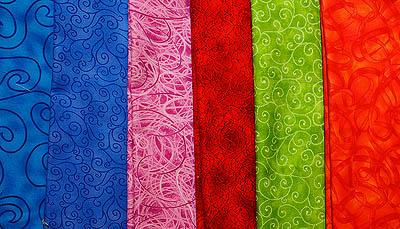 A variety of bright fabrics