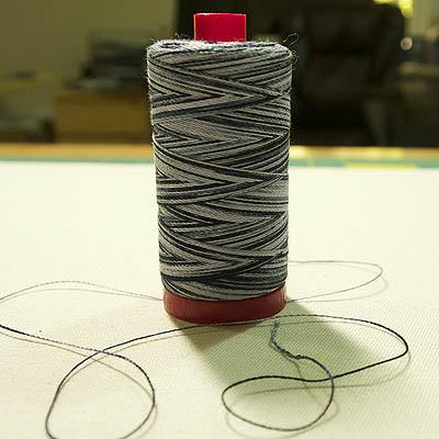 a spool of variegated grey/black thread