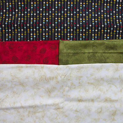 fabrics in cream, green, red and brown with coloured circles