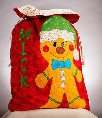 Red santa sac with a gingerbread man