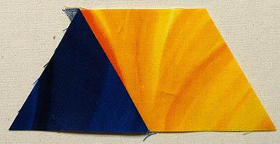Blue triangle sewn to a yellow diamond