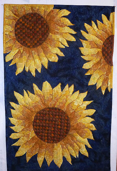 3 sunflowers in golden yellows