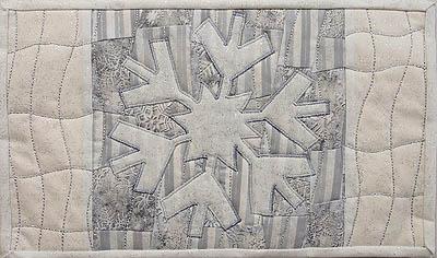 Completed snowflake mug rug