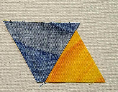 blue triangle sewn to yellow diamond