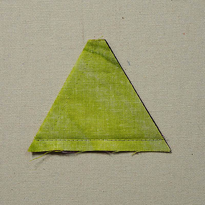 Green triangle with seam line at the bottom
