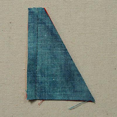 Seam line down straight edge of half triangles