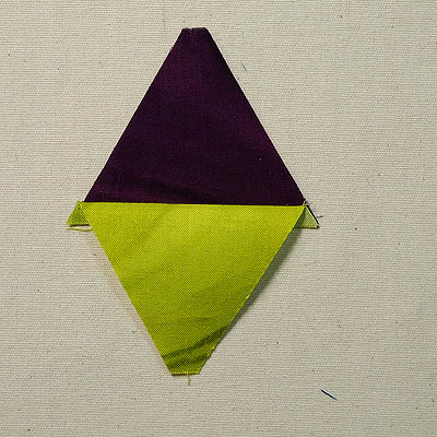 Purple triangle on top of a green triangle