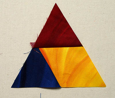 Red & blue triangles sewn to a yellow diamond