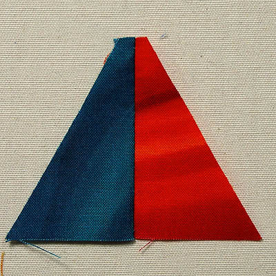 An orange and teal triangle