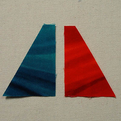 Mirror image half triangles in teal and orange