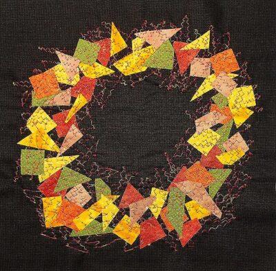 autumn coloured wreath of fabric bits