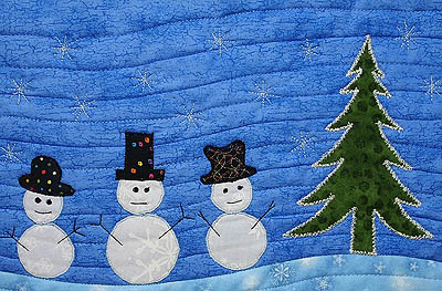 Close up of appliqué, quilting and stitching