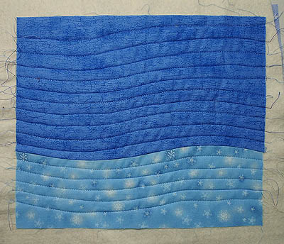 Quilting mimics the sewn curve of the two pieces