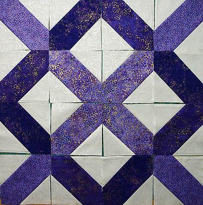 Purple blocks create an X and an O