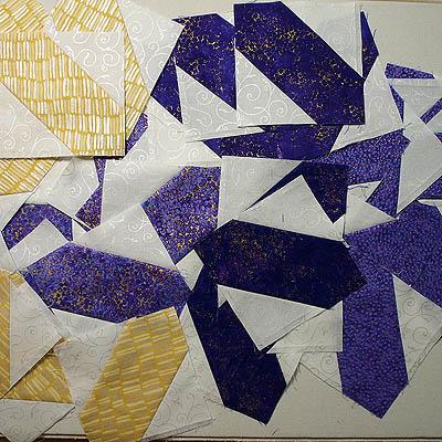 Several left over hatchet blocks in purple, yellow & white