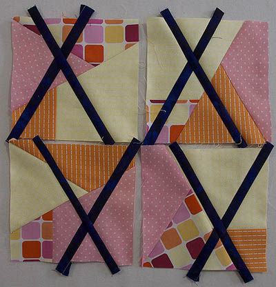 Each block has 2 dark blue contrasting strips making an X in the block