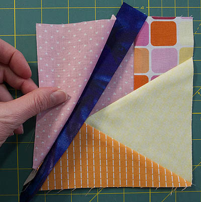 Contrast strip sewn wrongly between the two block pieces