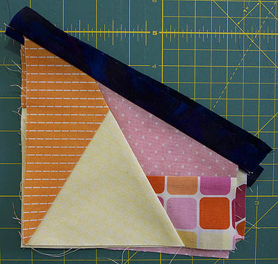 Blue strip sewn to orange/yellow/pink fabrics