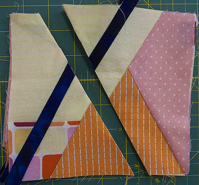 A second cut angled through the block and contrasting strip