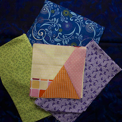 Several fabrics auditioning as contrast for the blocks