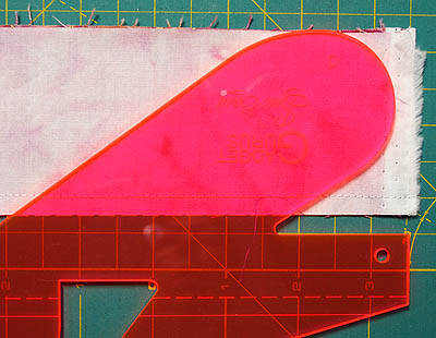 Template lying on pink fabric