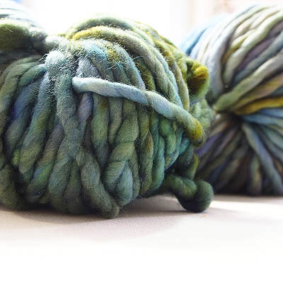 skeins of chunky yarn in green and blue