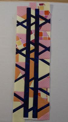Blue strips sewn between orange/yellow/pink strips