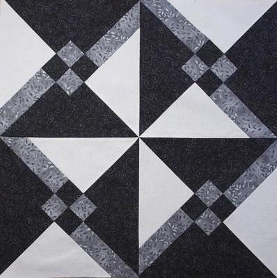 4 Granny's Choice blocks sewn together to make a pinwheel