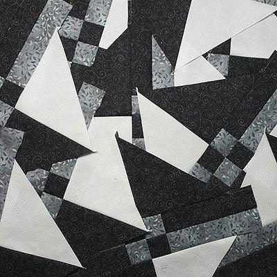 A pile of black/grey/white blocks